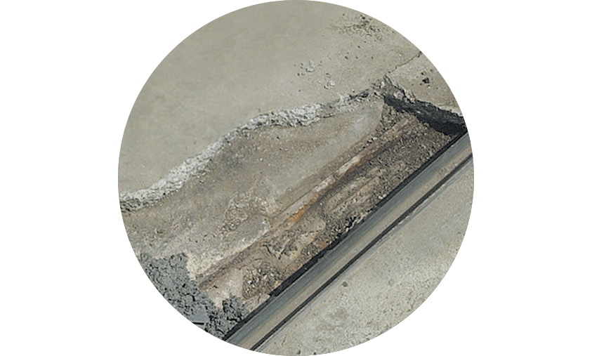 Repair that is typically filled in with Concrex deep fill near a rolling shutter door